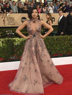 Strike a pose: Empire star Taraji P. Henson glittered in a ballgown with sheer bodice...
