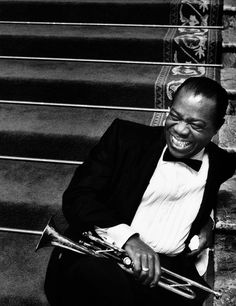 Louis Armstrong, style, music, jazz.  Saw him 6th row in concert, Stambaugh Auditorium, 1964.