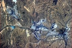 Mining town in Northern China, the open pits gleam with blue from space. (has left a scar forever) (Col Chris reports that the testing of the thresters was very successful. A reminder that he will be heading home in days.  Will miss these great pictures and reports everyday but happy he will be home with his family on Earth.)