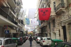 "Art students ""airing their linen in public""!   An original art installation, with sheets hung from building to building, was placed on central streets of Thessaloniki (Greece)."
