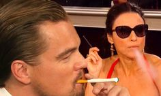Holy smokes! Leonardo DiCaprio and Julia Louis-Dreyfus puff away INSIDE the Golden Globes... but they keep it legal with electronic cigarett...
