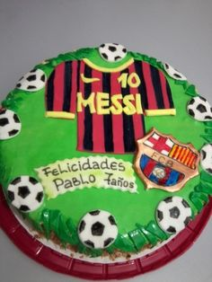 Soccer cake...although, it would look better as Mia Hamm on it not Messi