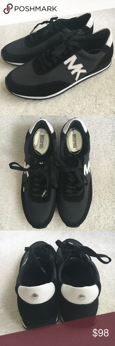 Michael Kors tennis shoes Black and White tennis shoes by Michael Kors. Great condition ( not included in bundle deal) Michael Kors Shoes Sneakers