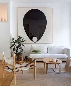 Bold graphic art and quiet neutral furniture