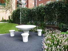 Courtyard in Stockholm, ivy, birches, pergola, concrete, furniture from Amop. Design and planting by Garden by anna.