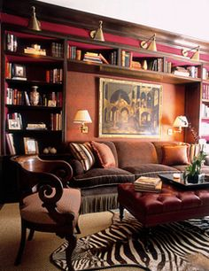 warm, cozy library seating against the wall with additional lighting above and at the reader level.