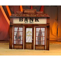 This Old West Bank and Trust Standee is a must-have addition to any western themed event. Our Western Bank is made of cardboard and features a custom printed design.