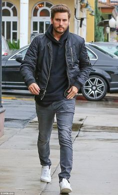 Marry a black bomber jacket with grey jeans to effortlessly deal with whatever this day throws at you. White low top sneakers are a smart choice to complete the look.   Shop this look on Lookastic: https://lookastic.com/men/looks/black-bomber-jacket-black-hoodie-grey-jeans/18373   — Black Hoodie  — Black Bomber Jacket  — Grey Jeans  — White Low Top Sneakers
