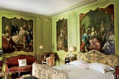 Decorated by Stephane Boudin in the 1950s, the Bishop's Room features antique paintings set within carved moldings, an embroidered bed, and a Louis XV leather-clad sofa.