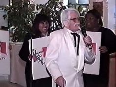 """Colonel Sanders Office Christmas Party Performance (Taco Bell, Pizza Hut and KFC Competition) In the 2002 Burger Busters Office Christmas Party, there were 6 accountants on Byron's team (CFO of Burger Busters) and he needed to win out on the Office Christmas Party. Byron would do anything! He wasn't chicken and dressed up like Colonel Sanders to clinch the match. To the tunes of: """"Start me up"""" or renamed """"Pizza Hut"""", """"Ring my bell"""" -for Taco Bell""""..and others watch and enjoy..."""