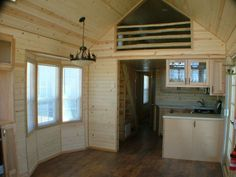 Hergert - Rich the Cabin Man - tiny house with built in stairs / storage & propane heater underneath