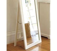 Nice floor mirror and you wouldn't need to hang it on the wall