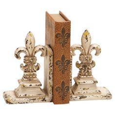 Set of 2 distressed fleur-de-lis bookends.  Product: Set of 2 bookendsConstruction Material: PolystoneCol...