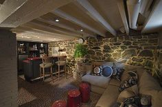 Exposed stone in the basement bar/lounge area is sealed to create a cozy space f. Exposed stone in the basement bar/lounge area is sealed to create a cozy space for unwinding after Basement Bar Plans, Old Basement, Basement Bar Designs, Basement Remodel Diy, Modern Basement, Basement Makeover, Basement Walls, Basement Bedrooms, Basement Renovations