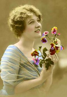Young woman with pansies. Love the hand colored photos.