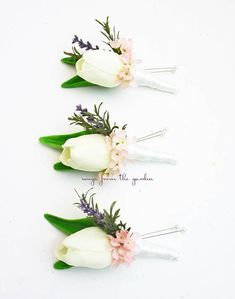 For your groom and groomsmen, this Real Touch white tulip boutonniere is accented with artificial lavender sprigs and pink wax flower and can be customized for your color scheme. This Real Touch white tulip boutonniere is accented with lavender sprigs and pink wax flower and is
