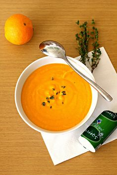 (For 2-2.5 liters of soup)  1 Cucurbita moschata pumpkin (or 1.5 kgs of ordinary pumpkin)  1 medium-size carrot  1 medium-size sweet potato  1 small onion  1 trunk of leek  30 gr. butter  3 branches of thyme  water  2 oranges  250 gr. low fat cream  100 gr. young white goat cheese