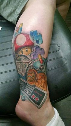 How awesome is this?! My wifey's Nintendo tattoo!! By Meghan Patrick @ 12oz Studios in Brooklawn, NJ