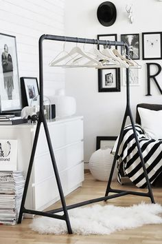 Styling your room in a black-and-white theme is simple with the open closet look. And if you're craving color, let your clothes do the talking. So, have we converted you into loving...