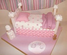Little Girls Bed Cake - This was for a cake class I attended, which we had to make a bed. It was up to us how we did it. Everything except the little teddy is made from Fondant. Have a Great Day!