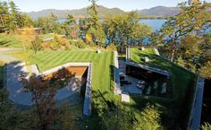 Lakeside Retreat  Peter Gluck and Partners  Adirondack Mountains, New York  Gluck and his architect-led design-build team created the 10,600-square-foot submerged family house and the 11,100-square-foot recreation building by excavating 14,000 cubic feet of rock from the site.  Photo © Paul Warchol