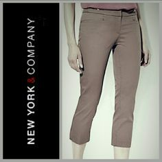 "NY & Co 7th Ave Straight Crop Pant A fresh new pant style, just in time for the new season! A slim, straight-leg silhouette that sits just below the waist. This crisp, cotton-blend pant is adorned with polished silvertone hardware. Dress up for work or down for weekend wear. Retails for $34.95.  Details:  * Size 14 * Color Broadway Brown * Zip front with hook-&-bar closure. * Wide waistband w/hardware detail. *Front slash pockets. *Back welt pockets. * Inseam: 21  * Sideseam 31.5"" * 78%…"