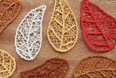 Make your own skeleton leaves with this needle lace technique - all it takes is some embroidery floss, sewing thread, and a paper template! cool autumn or folk art embellishment craft for using on clothes , jackets , book covers and cards Embroidery Designs, Paper Embroidery, Embroidery Stitches, Machine Embroidery, Embroidery Floss Crafts, Embroidery Online, Purl Bee, Textiles Techniques, Needle Lace
