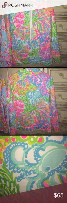 Lilly Pulitzer lovers coral popover XS Excellent condition I don't see any piling stains or rips. Looks great and I love the print placement ! I paid retail for this item when it first launched. Please check out my bundle discount and keep in mind that posh keeps twenty percent of sellers' earnings -- this is to explain my pricing choices. Lilly Pulitzer Tops Sweatshirts & Hoodies