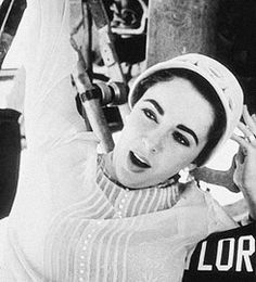 Elizabeth Taylor on the set of Giant, photographed by Sid Avery, 1955. S)