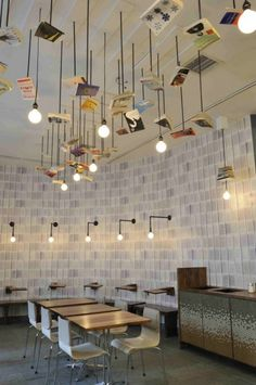 A coffee shop where every single element of the design was rooted in a theme. I would like to live here. McNally Jackson Cafe by Front Studio Architects