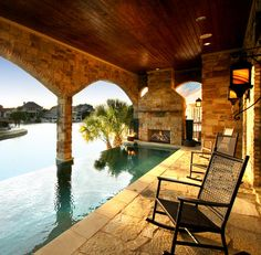 Lake House Applehead Island, Horseshoe Bay Texas  http://www.zcustomhomes.com  This lakeside home in Horseshoe Bay was built as a retreat for the Houston family. They desired to have the pool cascade into the lake below, requiring it to be built on the second story of the home. This home was the recipient of the Texas Star Award for Best Outdoor Living Area.