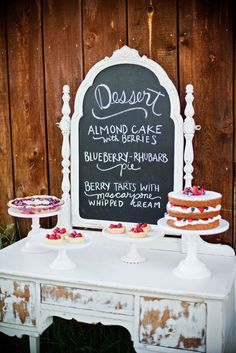 Shabby chic dessert table with chalkboard menu sign.