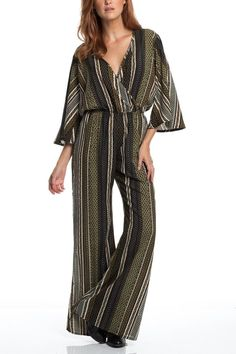 Gorgeous printed, elastic waist, 3/4 sleeve pantsuit. Featuring a criss crossover bodice with hidden snap closure and soft flowing fabric.   Printed Pantsuit by Amy's Allie . Clothing - Jumpsuits & Rompers - Jumpsuits Ohio