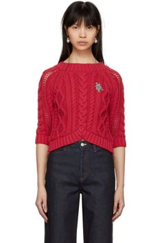 Three-quarter sleeve cable knit sweater in 'espelet' red. Rib knit crewneck collar, cuffs, and hem. Multicolor beaded appliqué at bust. Tonal stitching.