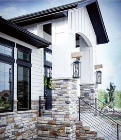 Modern Colorado Farmhouse. The white, black and stone look so beautiful together!