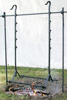 A great option if you're cooking food over the open fire often. over campfire fire pits Wrought Iron Hanging Grills Metal Projects, Welding Projects, Outdoor Projects, Welding Art, Woodworking Projects, Blacksmith Projects, Rocket Stoves, Outdoor Fire, Outdoor Sheds