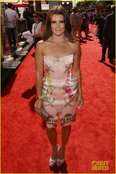 Admire the girly ensemble rocked by NASCAR superstar Danica Patrick, the most successful woman in the sport to date. The under-accessorized outfit helps this shapely, delicate-colored dress stand out for votes on potentially being the best dressed at the award show this year.