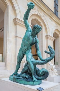 Hercules fighting Acheloos transformed into a snake sculpture from the Louvre Museum collection in Paris, France