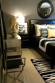 Pops of yellow reused in the bedroom (2010) paired with B&W