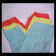 3 Pack of Leggings Set of preloved No Boundaries leggings. All in great condition. No damage. 1 light blue, 1 yellow, 1 bright pink. Made of nylon and spandex. Great for layering under skirts and dresses. All XL, size 15-17. No Boundaries Pants Leggings