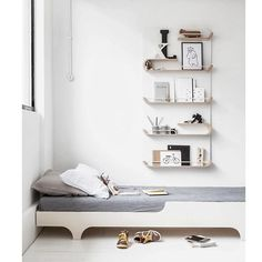 Kiddo room with simple style. Love the all white walls and the unique shelving…