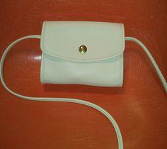 Mini Chrystie coach purse in cream.