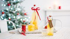 Bottles of limoncello on table | How to make limoncello | Tesco Living