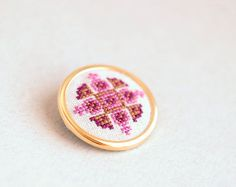 Ethnic hand embroidered brooch - pink and purple. $28.00, via Etsy.