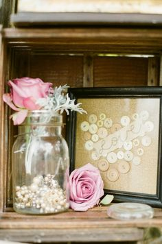 pearls and crystals in jars/vases with w pop of color flowers! Country Chic!  We have the crystals from our wedding you could borrow if you wanted and get the pearl mardi gras beads maybe from ebay or oriental trading.