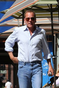 "Kiefer Sutherland Photos Photos - Kiefer Sutherland spotted having an outdoor meal with his girlfriend Siobhan Bonnouvrier and a friend at a restaurant in the West Village. The clean shaven ""24"" star is seen leaving the restaurant separately. - Kiefer Sutherland Gets Lunch in the West Village"