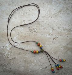 Fun. Simple. Youthful. Add a dash of color to your plain tee with this handmade ceramic bead necklace. Unique gift for that special girl. Gift packed.