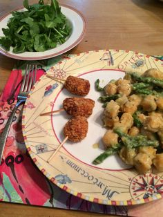 Oven-baked Chicken parmigiana lollipops (stuffed with cheese, chicken and sauce), served with home-made fried diablo sauce. Gnocchi and asparagus in a butter and sage sauce. Arugula salad with Caesar dressing. #PassThePlate #FamilyDinner