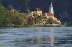 Duernstein in the Wachau Valley of Austria. The Danube Bike Trail winds along the cobblestone streets of this town best seen from the river. Wachau Valley, Vienna Woods, Danube River Cruise, Great Vacations, Bike Trails, Filming Locations, Favorite Holiday, Austria, Places Ive Been