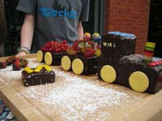Train cake, Birthday cake for my nephew.  Easy to make : 2 vanilla cakes, cut into desired pieces, create the train, use dental sticks to connect the wagons,  cover with chocolate, decorate with candy and fruit, use cookies for the wheels !